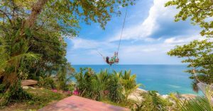 8 Reasons to visit Rock Beach Swing in Phuket Thailand including things to do like a stairway to heaven!